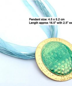 Oval enamel pendant necklace with silk cord